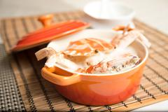 Female Crab Congee Horizontal in Chinese stew on bamboo tray Stock Photos