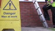 Building site worker climbing down the ladder Stock Footage