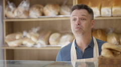 4K Customer in a bakery shop making contactless payment by cell phone Stock Footage