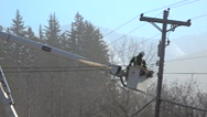 Power Line Utilities Worker In High Lift Bucket Stock Footage