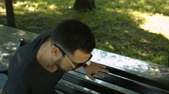 Young Man Typing a Phone Number Stock Footage