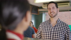 4K Customer in a bakery shop being served at the counter Stock Footage