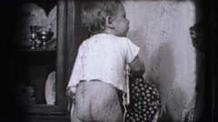 1942: a baby boy nake but playing smiles outdoor old timey feeling LOS ANGELES, Stock Footage