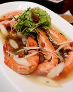 The locally sourced tiger prawn with American distinctive ginseng-taste on wh Stock Photos