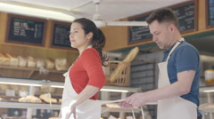4K Happy couple - small business owners preparing for the day in bakery shop Stock Footage