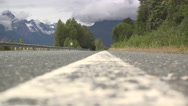 Vehicle Passing on Rural Mountain Highway Stock Footage