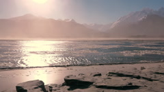 Winter Sandstorm and Ice Clad Mountain River Stock Footage
