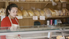 4K Portrait happy couple business owners behind the counter in bakery shop Stock Footage