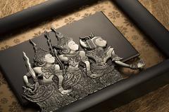 Indonesian plaque featuring three characters from Hikayat Seri Rama Stock Photos