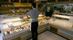 4K Time lapse workers & customers in busy bakery shop Stock Footage
