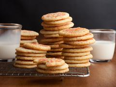 Chewy sugar cookies with glasses of milk on the table Stock Photos