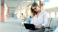 Businesswoman finish working on laptop while sitting on platform Stock Footage