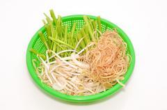 Basket of Vietnamese herbs on a white background Stock Photos