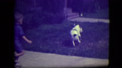 1946: the day mom and son were playing in the front yard with the dog LAS VEGAS Stock Footage