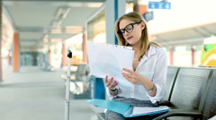 Businesswoman having a painful headache while sitting on the train station Stock Footage