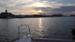 Pavillino under sunset off the port side catamaran with high clouds Stock Footage