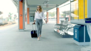Businesswoman walking in rush and doing serious look to the camera, steadycam sh Stock Footage