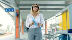 Morose businesswoman walking with rush and looking for train, steadycam shot Stock Footage