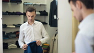 Man wearing suit at clothing store Stock Footage