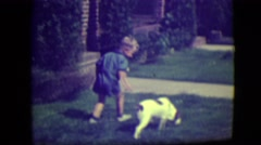 1946: oh, chores! learning to walk the boy! father sends young son out to walk Stock Footage