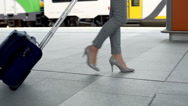 View of businesswoman's legs walking with on the train station Stock Footage