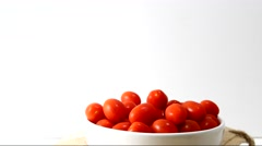 Rotating red grape tomatoes in a bowl Stock Footage