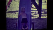 1946: kids playing on slides in a park LAS VEGAS, NEVADA Stock Footage