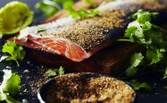 Garam masala salmon pepper with herbs on wooden table Stock Photos