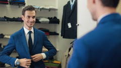 Successful Man wearing a jacket at boutique Stock Footage