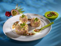 Pineapple passion veal tartare on white plate in restaurant Stock Photos