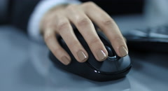 4K: A closeup view from a young woman hand with a computer mouse. Stock Footage
