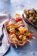 Veal skewers marinated with tarragon, rosemary and cumin on grey background Stock Photos