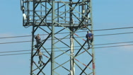 Industrial painters painting an electricity pylon Stock Footage