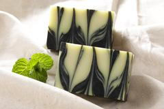 Charcoal soap deep cleansing with mint on cloth Stock Photos