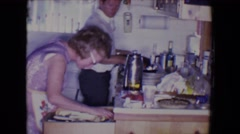 1961: cooking in the kitchen SALTON SEA, CALIFORNIA Stock Footage