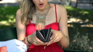 Worried girl looking on her empty purse after shopping, slow motion shot at 240f Stock Footage