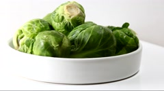 A container with fresh green Brussels sprouts Stock Footage