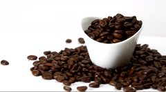 Rotating coffee beans in a container on white background Stock Footage