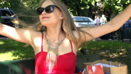 Pretty girl relaxing and enjoying herself in the park, slow motion shot Stock Footage