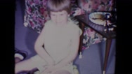1961: two kids are playing with toy cars. they are brothers and they are happy Stock Footage