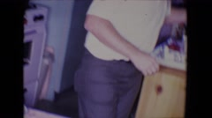 1961: middle aged couple cooking in the kitchen SALTON SEA, CALIFORNIA Stock Footage