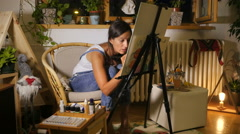 Young female artist makes a mistake, and fixes it. Stock Footage