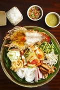 Tray of fried lobster with potatoes, vermicelli, green bean, vegetables, rice Stock Photos