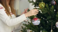 Decorating the Christmas tree with balls Stock Footage