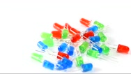 Red, green and blue LED lights rotating on a white background. Stock Footage