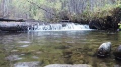 A small waterfall in the forest clean. Siberia. Khakassia. Stock Footage