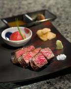 Delicious roasted Teppanyaki Japanese Yaeyama wagyu beef with wasabi and toam Stock Photos