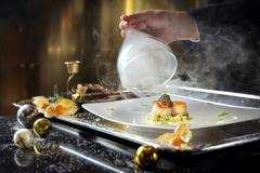 Pan seared diver scallops with smoked potato gnocchi and Oscietra caviar Stock Photos