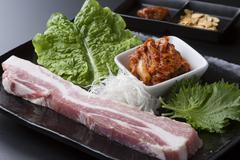 Fresh loin pork with lettuce and kimchi on black dish Stock Photos