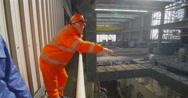 4K Interior view of huge industrial power plant & male & female engineers Stock Footage